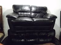Black leather 3 and 2 sofas