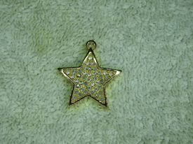 9ct Gold plated star pendant with CZ stones