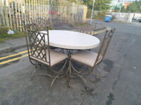 59. White wood and steel table and 4 chairs