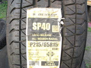 New set of 4 Dunlop 215/65R15 SP40 radial tires
