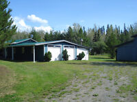 7 Acres with large home and shop