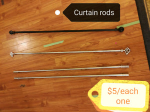 Various curtains and curtain rods.