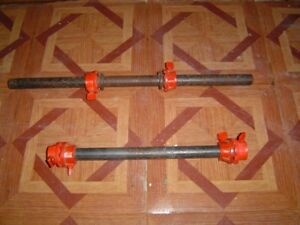 TWO SOLID METAL DUMBELL BARS WITH COLLARS