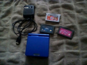 blue Gameboy advance and 2 games and 1 movie