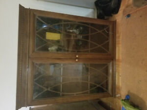 Beautiful dark stained wood cabinet w/metal detailed glass doors