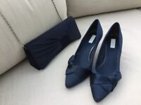 Navy satin shoes and matching bag.