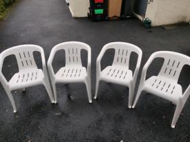 ***SOLD*** 4 White Plastic Garden Chairs