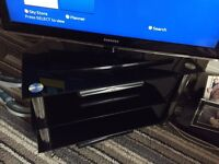 Black glass TV corner stand.