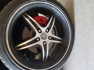 """Set of 4 20"""" low profile rims and tires for sale"""