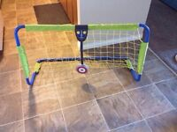 Soccer net with goal keeper