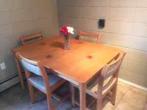 Beautiful Four-Seater Wooden Table Set with Extension Leave