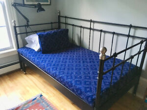 Next to New Wrought Iron Daybed (Mattresses,Bedding, Light incl)