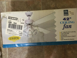 Ceiling fan still in box. Tag shows $49.99 - willing to let go f
