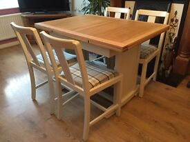 Solid wood extending table with four chairs