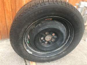 Set of 4 used snow tires on rims for sale