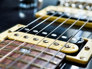 Ajustement & réparation de guitare électrique - Luthier