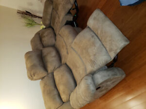 A sofa /  couch with double reclining
