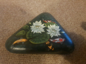 Painted rock and watering can