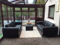 2 X 3 Seater Black Leather Sofas + Footrest From Habitat