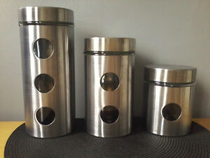 THREE PIECE GLASS WITH STEEL CANISTER SET