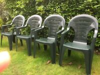 SET of FOUR GREEN PLASTIC GARDEN CHAIRS for SALE. AS NEW.