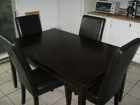 Wood table with 4 faux leather chairs