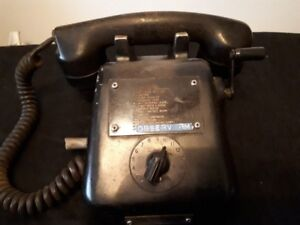 old bakelite ship phone with crank handle