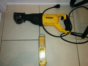 DeWalt 12 amp risipricating saw with blades