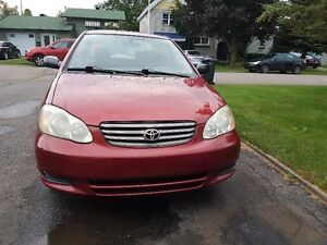 2003 Toyota Corolla, 5speeds,132K,A/C,Low Millage Nego!