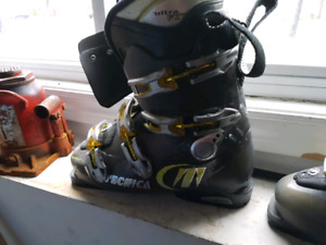 downhill skis, boots , carrying bag, helmet