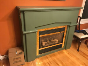 Propane fireplace, exhaust vent and fireplace surround for sale