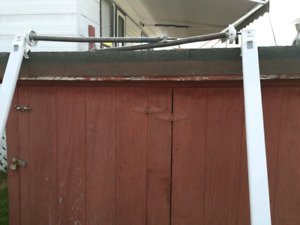 Trailer awning arms