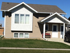 Sask home with basement suite/separate entrance/LG Yard