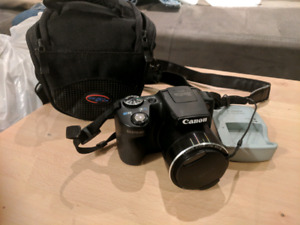 Canon camera (PowerShot SX510 HS) with case and charger