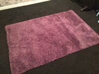Large purple rug and floor lamp with purple lampshade