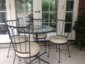 Hauser glass table and 4 chairs....black wrought iron