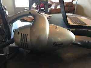 Hand held shark vacuum