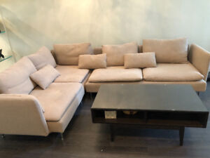 $200 IKEA sofa with an extra sofa cover and a matching table