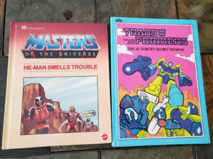 Large hard cover vintage books TRANSFORMERS & HE-MAN