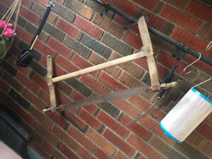 Antique Crib, Garden Hose Reel and Saw