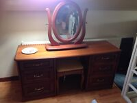 Bedroom furniture set includes dressing table and bed side draws