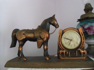 Heavy metal electric horse clock   $60.