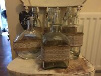 Wedding table hessian and lace glass bottles