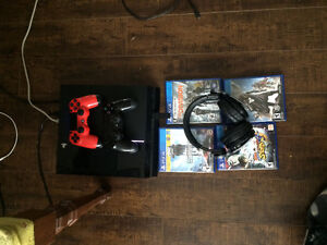Ps4 with 2 controllers, wireless headset, games and all cords an