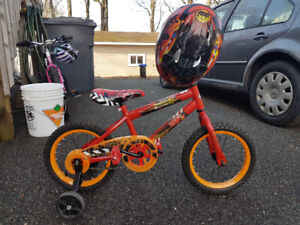 Kids bike with training wheels and matching helmet.