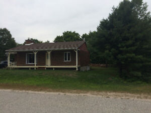 Temiscaming QcFull brick house with garage on large lot for sale