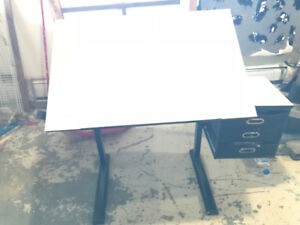 Adjustable drawing/drafting table with small drawers