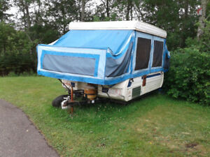 Older hardtop trailer with new canvas