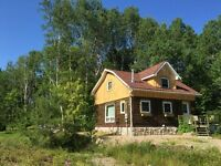 Beautiful log home with guest Bunkie on 11 acres in Redbridge
