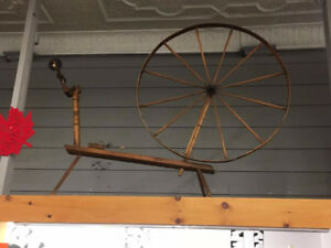 Massive antique spinning wheel